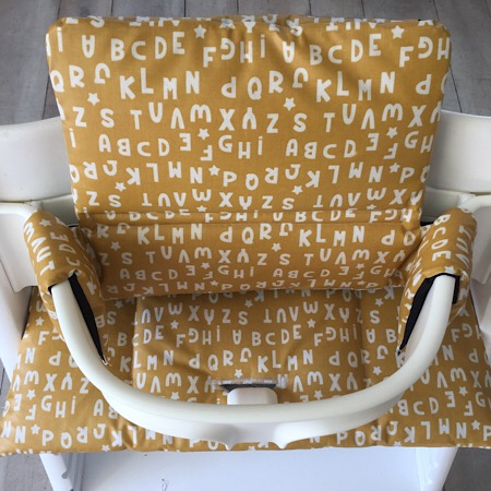 Stokke Tripp Trapp Kussenset letters oker geel