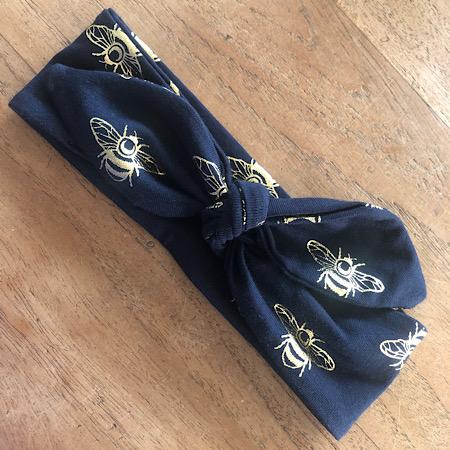 Haarbandje donker blauw met gouden bijen