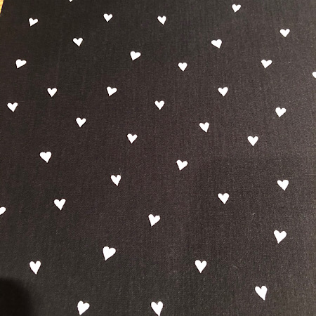 Stokke Newborn hoes zwart met witte hartjes